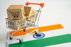Box with shopping cart logo and India flag, Import Export Shopping online or eCommerce finance delivery service store product shipping, trade, supplier concept. photo