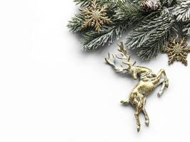 Christmas composition with deer, snowflakes and fir branches. photo
