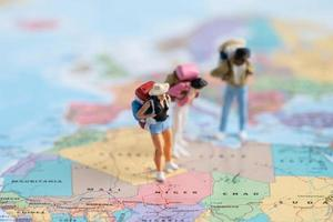 Bangkok, Thailand, July 30, 2021 Miniature people,Backpacker enjoy to discovery journey travel at amazing on world map. photo