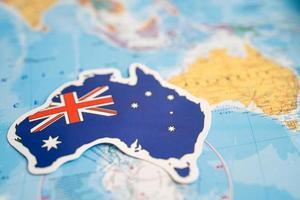 Bangkok, Thailand - September 20, 2021 Australia flag on world map background. flag on world map background. photo