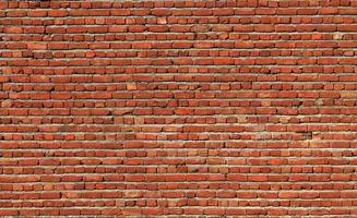 Fondo de primer plano de pared de ladrillo rojo foto