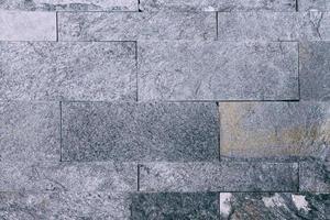 pared de azulejos de mármol negro foto