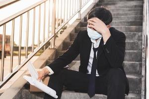 Asian Failure unemployed businessman stress sitting on stair photo