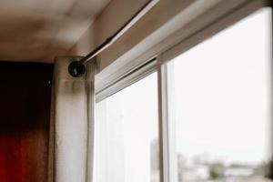 Closeup shot of a bright window with open curtains photo