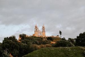 Beautiful antique church under a cloudy sky photo