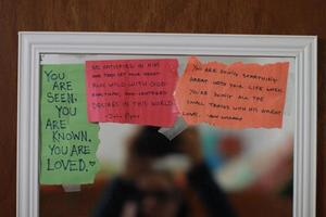 Closeup shot of inspirational and motivational notes on a mirror photo