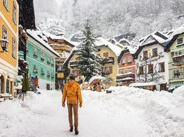 people from behind young man in yellow winter jacket photo
