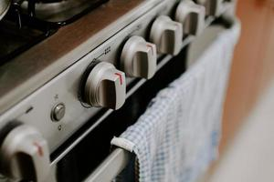Selective focus shot of a gas stove in the kitchen photo
