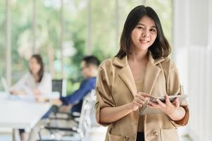 business woman using digital tablet in meeting room photo