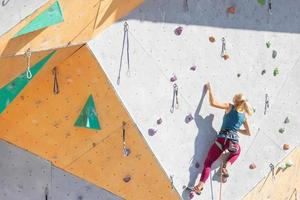 girl is engaged in rock climbing photo