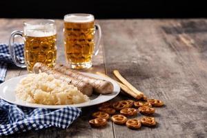Bratwurst sausage ,sauerkraut, pretzels and beer photo