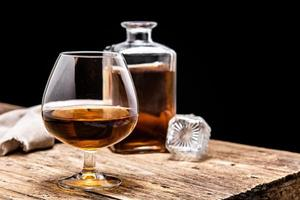 Cognac or whiskey drink on rustic photo