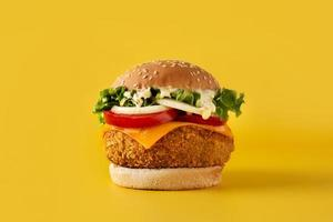 Crispy chicken burger with cheese photo