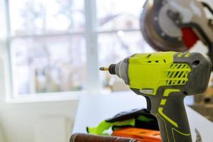 A set of construction tools cordless screwdriver drill circular saw soft focus photo