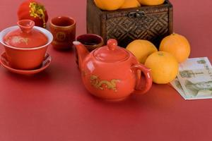 Chinese New Year decoration festival decorations of accessories in traditional container mandarin oranges on red background photo