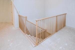 Wooden planks around pole stairs handrails renovation for wooden railing for stairs photo