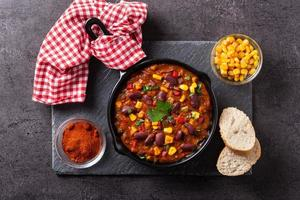 Traditional mexican tex mex chili con carne in iron pan photo