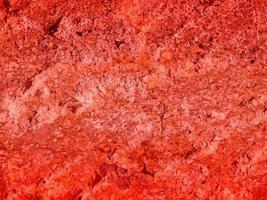 textura de piedra roja fuera foto