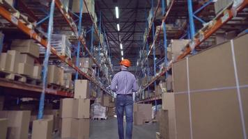 Men goes in storehouse. video
