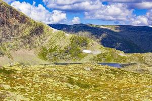 Amazing Norway landscape boulders and lake summit top of mountain photo
