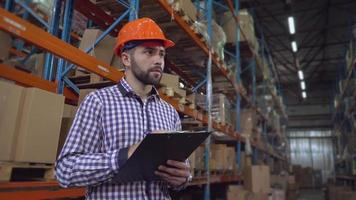 Employee working with documents in storage. video