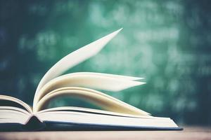 Open book with green board background photo