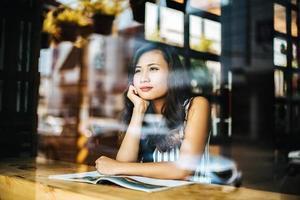 Beautiful woman reading magazine in cafe photo