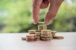 Saving money concept . hand putting money coin stack photo