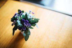 Flower in vase on table at coffee shop photo