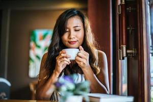 Portrait asian woman smiling relax in coffee shop cafe photo