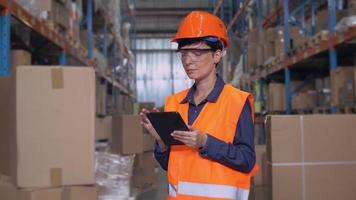 Portrait female at work in storehouse. video