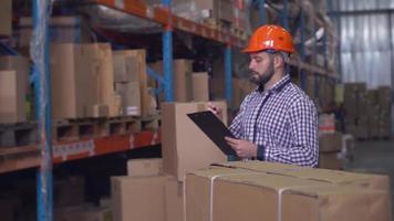 Employee in storehouse handwriting. video