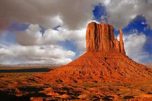 Sunset in Monument Valley Utah With Cloudy Sky photo