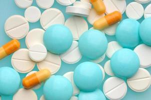 Pills on wooden background photo