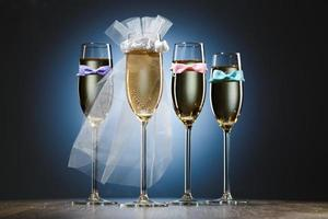 Glasses of champagne for bride and gentlemens photo