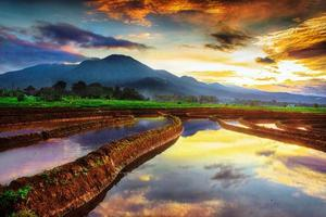 mountain view in the morning with beautiful reflection of the rising sky photo