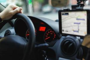 View of a speedometer, steering wheel and navigator on a dashboard photo
