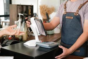 Barista is using the screen to receive orders from customers. photo