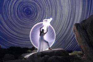 Posing Woman Light Painted Under the North Star Trails photo