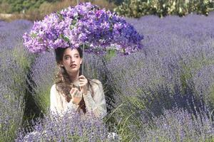 Pretty Young Girl Outdoors in a Lavender Flower Field photo