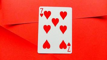 Playing cards are red on a red background photo