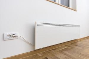 Smart heater convector. Smart Home with the smart heating system. Electric panel heating concept. photo