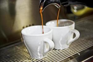 Espresso machine working with bar interior background photo