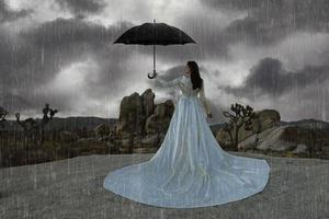 Abstract Concept of Girl Surrounded In Desert Raining photo