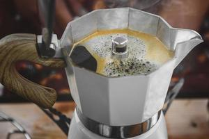 Coffee making with Moka pot and snack. photo