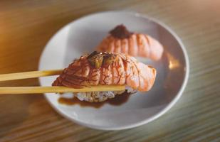 Salmon sushi grill top with foie gras. photo