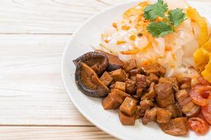 Chinese steamed rice noodle with pork and tofu in sweet soy sauce photo
