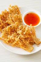 deep fried enoki mushroom or golden needle mushroom with spicy dipping sauce photo