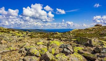 Amazing Norway norwegian landscape boulders at summit top of mountain photo