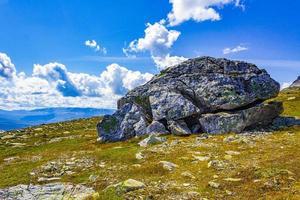 Big rock in amazing norwegian landscape mountain top Vang Norway photo